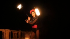 Beautiful girls juggle fire. Close-up. Slow motion Stock Footage