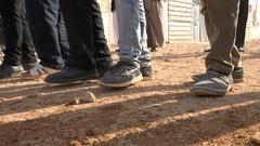Shoes of young men dancing during marriage, Syrian refugee camp Zaatari Jordan Stock Footage