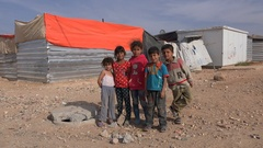 Curious Syrian kids pose for camera in refugee camp Jordan Stock Footage