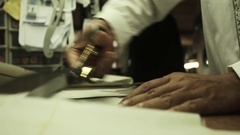 Bespoke tailor working at a factory Stock Footage