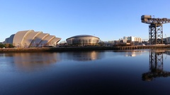 Panning view of Glasgow waterfront with SECC and Finnieston Crane, Scotland Stock Footage