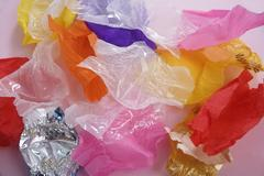 Empty candy wrappers Stock Photos