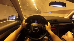 Point of view time lapse driving a car through a tunnel and a mountain road Stock Footage
