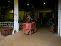 Man Riding on a Forklift. Metallurgical Plant Stock Footage