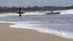 A surfer holdng his board and checking out the waves Stock Footage