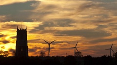Church / wind farm sunset timelapse (zoom in) Stock Footage