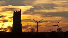 Church / wind farm sunset timelapse (pan right) Stock Footage