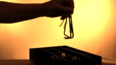 Silhouette of hands taking hex keys from a box. Stock Footage