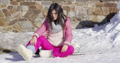 Young asian snowboarder girl relaxing Stock Footage