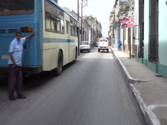 Fast movement behind white car on the narrow street in cuban city Stock Footage