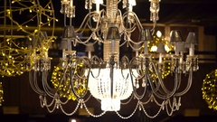 Crystal chandelier with yellow garlands on the dark background 4K Stock Footage