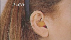 VHS ear plugs woman detail Stock Footage