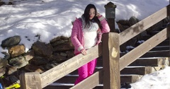 Adorable asian girl standing on wooden stairs Stock Footage