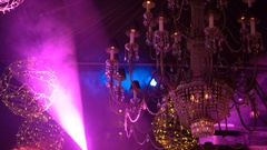 Crystal chandelier with golden garlands and soundlights 4K Stock Footage