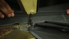 Sewing machine making stitches on a bespoke tailored suit Stock Footage