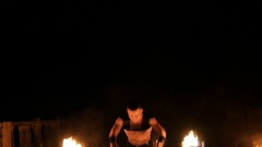 Man performs a trick with fire Stock Footage