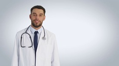 Mid Shot of a Warmly Smiling Doctor Crossing His Arms. Shot on White. Stock Footage