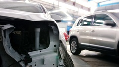 Different cars standing in garage - automobile service, slider Stock Footage