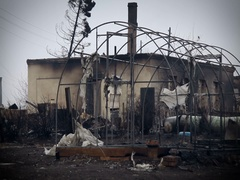 Burned Building and Frame the Greenhouse. View of the Burned Village Stock Footage