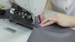 Hands of a worker to work with the sewing machine Stock Footage