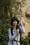 Young woman with walking stick Stock Photos