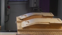A CNC machine in action using the wooden sheet Stock Footage