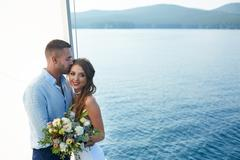 Married young couple having honeymoon voyage Stock Photos