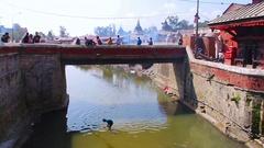 People on a stone bridge in asian village Stock Footage