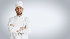 Mid Shot of a Handsome Chef Crossing Arms and Smiling. Shot with White Backgroun Stock Footage