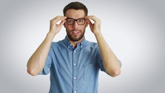 Mid Shot of a Stylish Young Man Correcting His Glasses and Crossing Arms.  Stock Footage