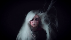4K Horror Witch with Bloody Tears and Wind in White Hairs Stock Footage