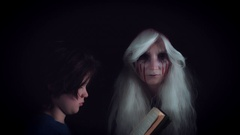 4K Horror Witch Appears from dark and Child Reading Story Book Stock Footage