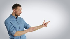 Shot of a Stylish Man Making Presenting/ Advertising/ Finger Guns Gesture.  Stock Footage