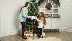 Mother gave her daughter a gift Stock Footage