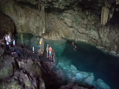 Panoramic view to the underground cave and lake with blue water Stock Footage