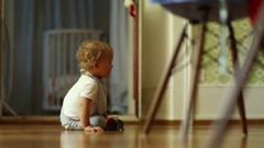 Baby crawling towards camera indoors Stock Footage