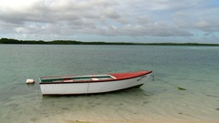 Boat tied to shore in bonaire caribbean island Stock Footage