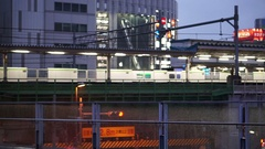 Train running depart from Akihabara station in the evening Tokyo Japan Stock Footage