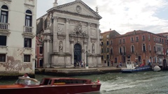 VENICE, ITALY - SEPT 15, 2016: Water taxi passes in front of San Stae Church Stock Footage