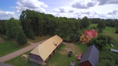 Aerial view of the cabin houses in the middle of the farm Stock Footage