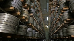 Vintage reel, video or audio tapes in a old media archives shelfs Stock Footage