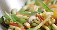 Healthy, colourful and nutritious vegetable stir fry in a wok Stock Footage