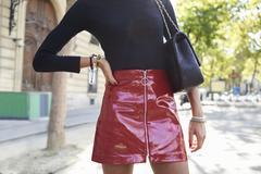 Fashionable woman in PVC miniskirt, horizontal crop Stock Photos