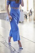 Woman in blue jumpsuit walking, low section crop Stock Photos