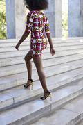 Black women wearing African inspired print dress, back view Stock Photos