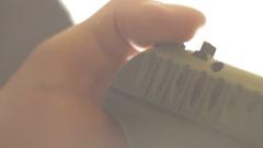 Man cocks the gun close-up Stock Footage