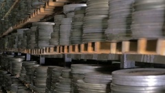 Old vintage film reel, film tapes in cases lying on archive shelfs. Dolly shot Stock Footage