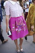 Woman in pink skirt with floral embroidery, vertical crop Stock Photos