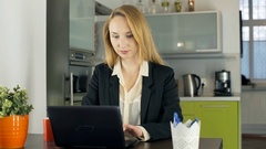 Businesswoman finish working on laptop and smiling to the camera, steadycam shot Stock Footage
