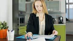 Businesswoman looks busy while working on documents, steadycam shot Stock Footage
